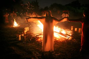 In this late Wednesday July 6, 2011 photo people celebrate the Slavic pagan holiday of Ivan Kupala, outside Novokuznetsk, Russia, about 3,000 kilometers (1,850 miles) east of Moscow. (AP Photo/Yaroslav Belyaev)